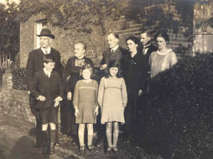 Outside the Ivy Cottage, 1926. George and Mary Clist with son John and Kate Clist visiting from NZ, with Jack (10), Edith (7), and Olive (10). Tom and Dorothy Bellamy at right.